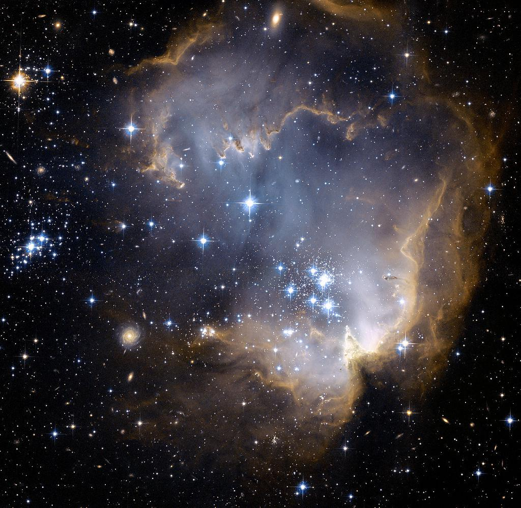 Presented image was obtained by the telescope Hubble. It shows the deep space object known as NGC 602. It is an emission nebula with a diffuse cluster located in the Small Magellanic Cloud.